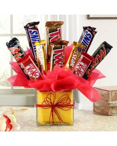 Glass Vase Decorated With Delicious Chocolates