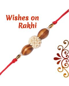 Send Oval Sandalwood Beads Rakhi Online